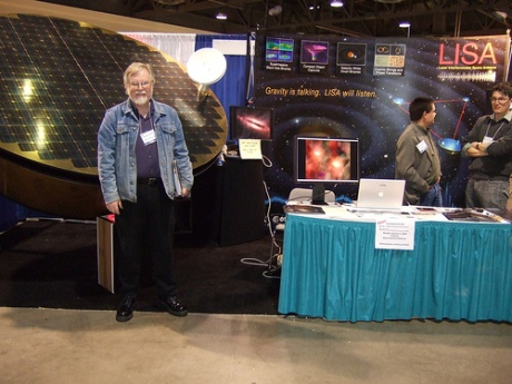 The author and a scale model of a LISA satelite