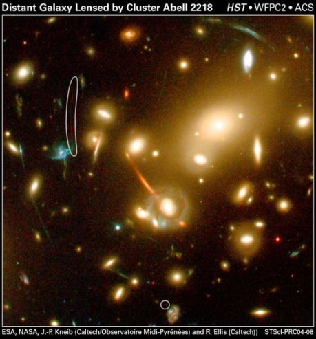 The warped images of distant galaxies appear as streaks of light