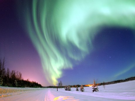 Aurora borealis co-created by solar flares.