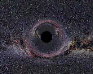 Illustration of what a black hole over the Milky Way might look like.
